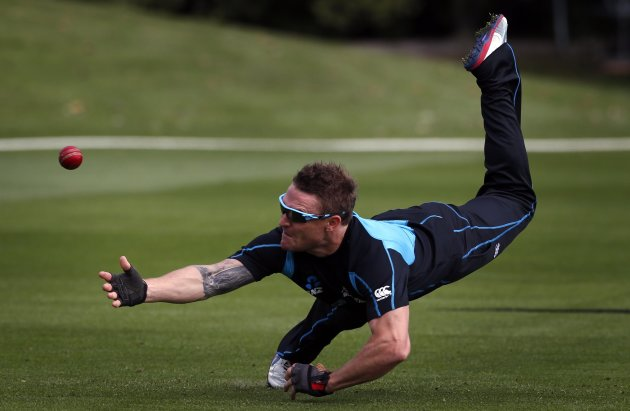 New Zealand cricket team player McCullum dives to try and take a catch during a training session at the University Oval in Dunedin