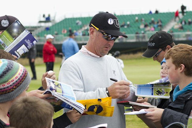 David Duval of the United States signs autographs after a practice round at Royal Lytham & St Annes golf club ahead of the British Open Golf Championship, Lytham St Annes, England Tuesday, July 17, 2012. (AP Photo/Tim Hales)