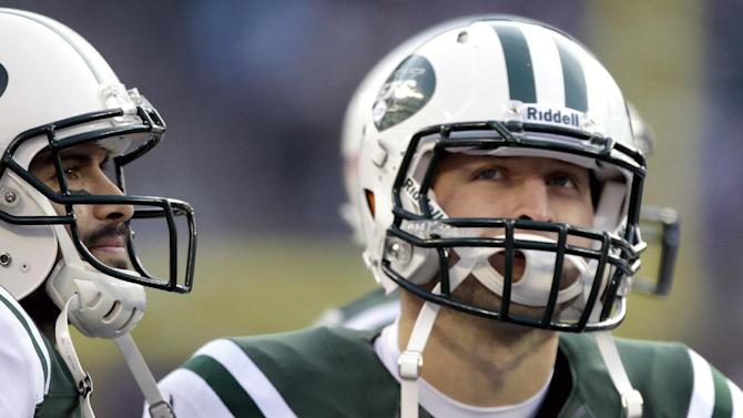 New York Jets quarterbacks Mark Sanchez, left, and Tim Tebow stand next to each other during the second half of an NFL football game against the San Diego Chargers, Sunday, Dec. 23, 2012, in East Rutherford, N.J. (AP Photo/Kathy Willens)