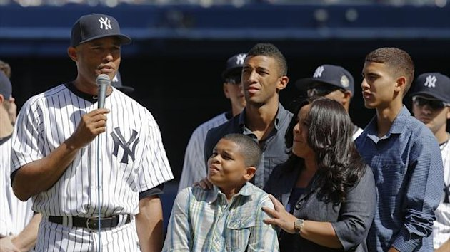 New York Yankees relief pitcher Mariano Rivera speaks to the fans as his family watches during ceremonies honoring the retiring Yankee before their MLB Interleague game with the San Francisco Giants at Yankee Stadium in New York (Reuters)
