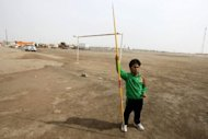 "Iraqi Paralympian Ahmed Naas stands in the open field in his hometown of Batha where he practises javelin. ""I thought I would be a king of sport in Iraq. I thought I would live like a king, that I would be a symbol for Iraq,"" the 20-year-old said"