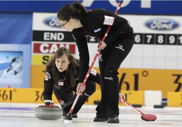 Canada's skip Homan delivers a stone during their World Women's Curling Championship qualification round match against Switzerland in Riga