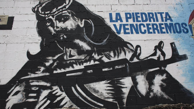 In this Sept. 16, 2010 photo, a mural depicting an image of Jesus Christ holding a machine gun covers a wall in La Piedrita or Little Rock neighborhood gang turf in Caracas, Venezuela.  Heavily armed gangs that pledge allegiance to President Hugo Chavez rule over fiefdoms in slums where police rarely patrol, employing vigilante justice and collecting extortion money. A shooting attack on the opposition candidate's entourage has kindled worries that Chavez's defenders could resort to violence if cancer impedes his bid for re-election. The gangs, however, are loosely organized and do not appear to be taking orders from the government. (AP Photo/Ariana Cubillos)