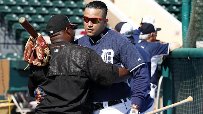 Detroit Tigers' Miguel Cabrera, right, hugs Baltimore Orioles coach Wayne Kirby before a spring training exhibition baseball game against the Baltimore Orioles in Lakeland, Fla., Tuesday, March 3, 2015.  (AP Photo/Gene J. Puskar)