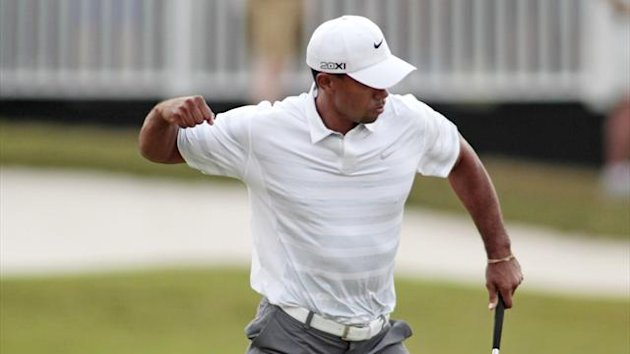 Tiger Woods reacts after sinking a birdie putt on the 18th green during third round play in the 2013 WGC-Cadillac Championship PGA golf tournament in Doral, Florida (REUTERS)