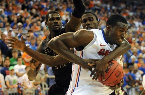 No. 11 Florida uses big 2nd half to beat FSU 82-64