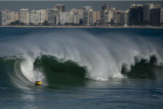 A body surfer rides a wave during high tide in Copacabana beach in Rio de Janeiro on may 22, 2012.  AFP PHOTO / Christophe SimonCHRISTOPHE SIMON/AFP/GettyImages