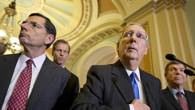 Senate Minority Leader Mitch McConnell, R-Ky., right, speaks with reporters following a GOP strategy session at the Capitol in Washington, Dec. 11, 2012, with from left, Sen. John Barrasso, R-Wyo., Sen. John Thune, R-S.D., and Sen. Roy Blunt, R-Mo.  (AP Photo/J. Scott Applewhite)