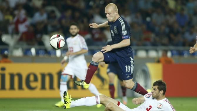 Scotland's Naismith fights for ball with Georgia's Kverkvelia during their Euro 2016 qualification match at Boris Paichadze Dinamo Arena stadium in Tbilisi