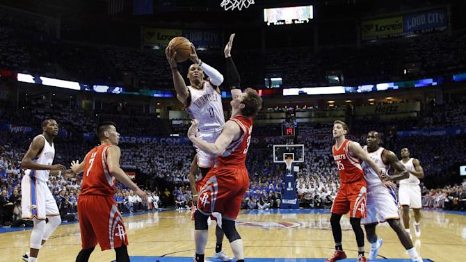 Oklahoma City Thunder guard Russell Westbrook (0) shoots over Houston Rockets center Omer Asik (3) in the first quarter of Game 2 of their first-round NBA basketball playoff series in Oklahoma City, Wednesday, April 24, 2013. (AP Photo/Sue Ogrocki)