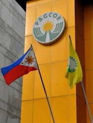 A Philippine flag flies in front of the headquarters of the government-owned Philippine Amusement and Gaming Corp. (PAGCOR) in Manila. Japanese gambling tycoon Kazuo Okada is accused of offering payments and gifts to two regulators at Pagcor