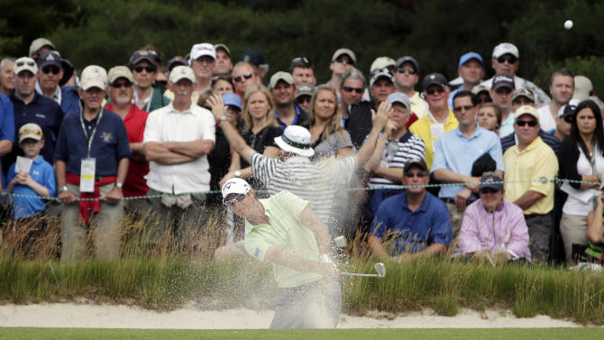 Nicolas Colsaerts, of Belgium, hits out of a bunker on the first hole during the second round of the U.S. Open golf tournament at Merion Golf Club, Friday, June 14, 2013, in Ardmore, Pa. (AP Photo/Charlie Riedel)
