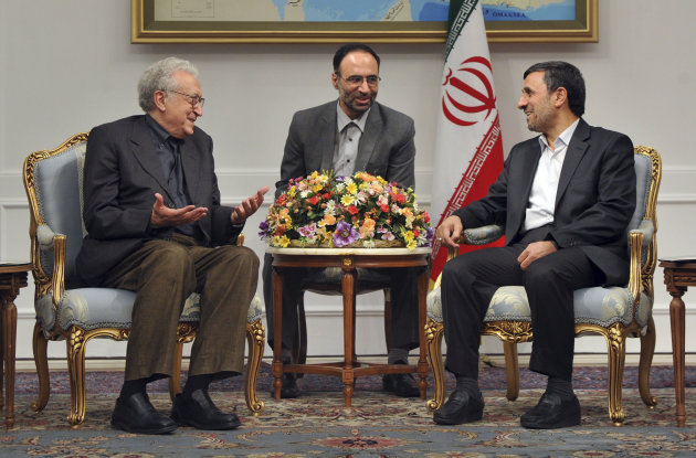 U.N. envoy on Syria, Lakhdar Brahimi, left, talks with Iranian President Mahmoud Ahmadinejad, during their meeting in Tehran, Iran, Sunday, Oct. 14, 2012. An unidentified interpreter sits at center. (AP Photo/ISNA, Amir Pourmand)