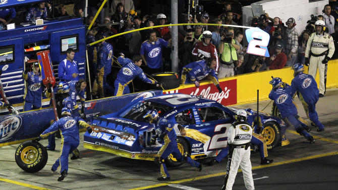Crew members perform a pit stop for driver Brad Keselowski during the NASCAR Bank of America 500 Sprint Cup series auto race in Concord, N.C., Saturday, Oct. 13, 2012. (AP Photo/Terry Renna)
