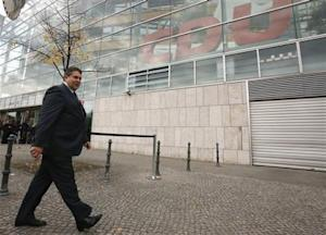 Leader of the SPD Gabriel leaves the first round of coalition talks between Germany's conservative (CDU/CSU) parties and the SPD in Berlin