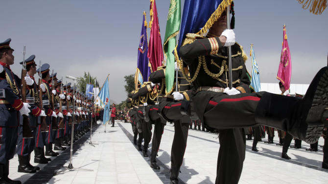 Members of the Honor Guard parade during Independence Day celebrations at Defense Ministry in Kabul, Afghanistan, Monday, Aug 19, 2013. Afghan officials mark the country's 94th independence day from Britain with a small military parade and folk festivals in the capital. (AP Photo/Rahmat Gul)