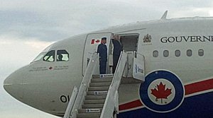 Prime Minister Stephen Harper waves as he boards a military Airbus for the flight to the G20 summit in St. Petersburg, Russia.