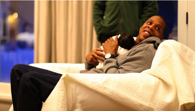 In this undated image released by Beyonce.com, rapper Jay-Z holds his daughter with singer-wife Beyonce Knowles, Blue Ivy in a recent family photo. Photos of the 1-month-old were posted by her parents