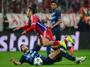 Bayern Munich's midfielder Thiago Alcantara (top) is fouled by Porto's Ivan Marcano