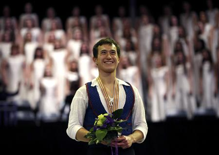 Patrick Chan of Canada poses with his gold medal at the presentation ceremony at the ISU World Figure Skating Championships in London
