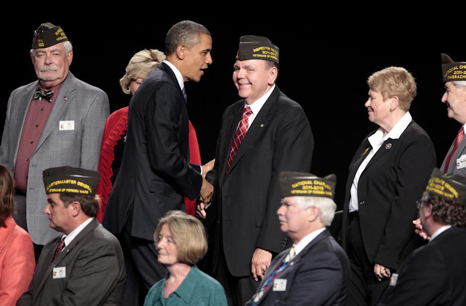 President Barack Obama shakse hands with member of the Veterans of Foreign Wars after his speech before VFW's 113th National Convention in Reno, Nev., Monday, July 23, 2012.(AP Photo/Rich Pedroncelli)