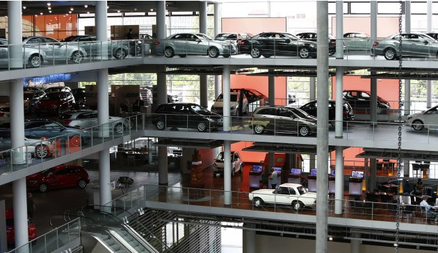 Mercedes-Benz cars are displayed in dealership of German car manufacturer Daimler in Munich