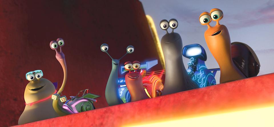 "This film publicity image released by DreamWorks Animation shows, from left, White Shadow voiced by Michael Bell, Smoove Move voiced by Snoop Dogg, Skidmark voiced by Ben Schwartz, Burn voiced by Maya Rudolph, Whiplash voiced by Samuel L. Jackson and Turbo voiced by Ryan Reynolds in a scene from the animated movie ""Turbo."" (AP Photo/DreamWorks Animation)"