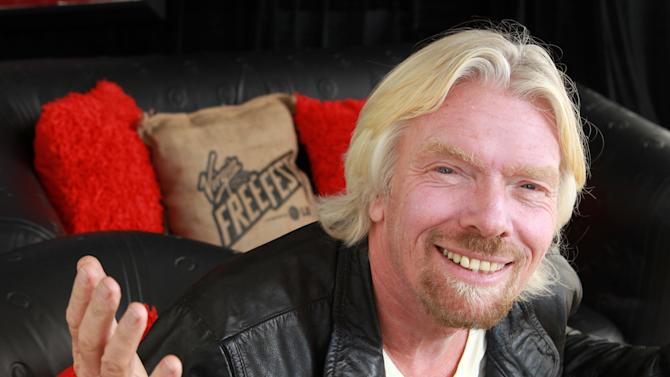IMAGE DISTRIBUTED FOR VIRGIN MOBILE - Richard Branson, chairman and founder of Virgin Group Ltd., poses for a photo at the 2012 Virgin Mobile FreeFest on Saturday, October 6, 2012 in Columbia, Maryland. (Photo by Paul Morigi / Invision for Virgin Mobile/AP Images)