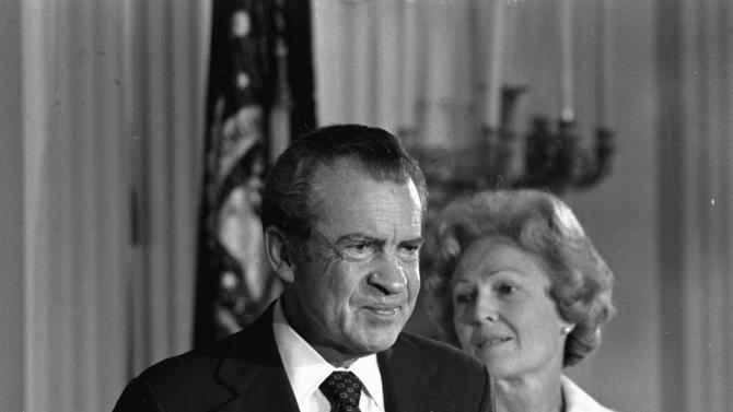 FILE - In this Aug. 9, 1974 black-and-white file photo, President Richard M. Nixon and his wife Pat Nixon are shown standing together in the East Room of the White House in Washington. Thirty-six years after Nixon testified secretly to a grand jury investigating Watergate, a federal judge orders the first public release of the transcript. (AP Photo/Charlie Harrity, File)