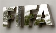 Water flows over the FIFA logo in front of the FIFA headquarters during heavy rainfall in Zurich July 22, 2011. REUTERS/Arnd Wiegmann