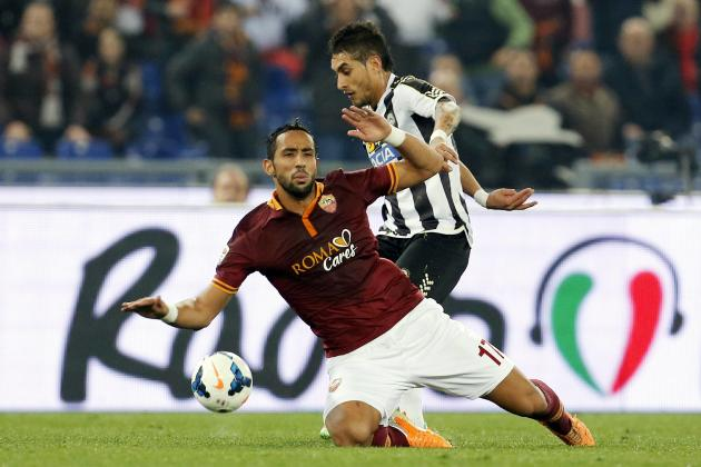 AS Roma's Benatia is challenged by Udinese's Pereyra during their Italian Serie A soccer match in Rome