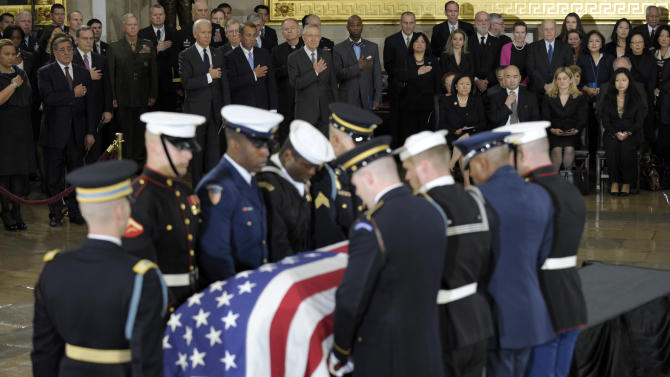 Members of Congress, staff and family, watch as the casket of Sen. Daniel Inouye, D-Hawaii, the second-longest-serving senator in history, is carried into the Capitol Rotunda in Washington to lie in state, Thursday, Dec. 20, 2012. Inouye was a Medal of Honor recipient who represented his state in the U.S. House and then the Senate, where he served for five decades. He died Monday evening at age 88 of respiratory complications. (AP Photo/Susan Walsh)