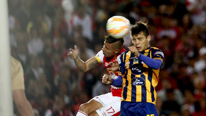 Roa of Colombia's Santa Fe fights for the ball with Baez of Paraguay's Sportivo Luqueno during their Copa Sudamericana match at the Campin stadium in Bogota