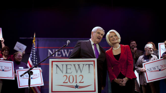 Republican presidential candidate, former House Speaker Newt Gingrich, left, and his wife Callista look into the crowd during a campaign stop on Friday, Feb. 24, 2012 in Everett, Wash.  (AP Photo/Evan Vucci)