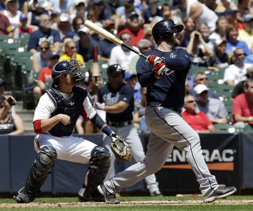 McCann's grand slam sends Braves past Brewers 7-4