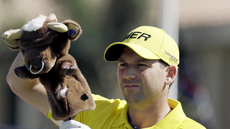 Sergio Garcia, of Spain, takes off the cover on his club as he prepares to tee off on the 11th hole during the first round of the Cadillac Championship golf tournament, Thursday, March 7, 2013, in Doral, Fla. (AP Photo/Alan Diaz)