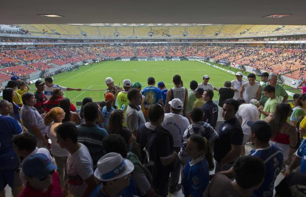 Fans arrive for the inauguration of the Arena Amazonia Vivaldo Lima soccer stadium in Manaus