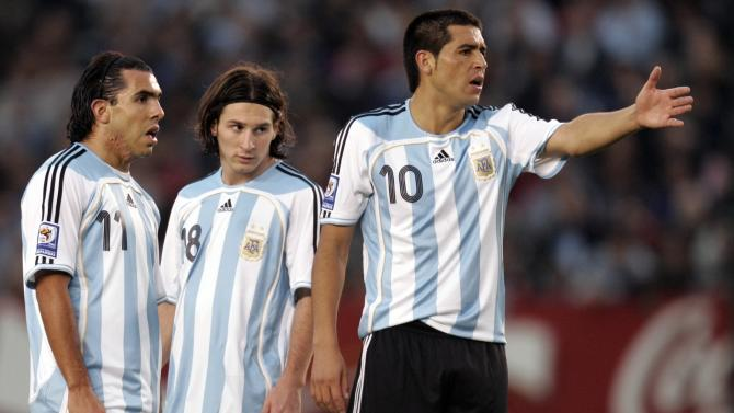 File photo of Argentina's Riquelme, Messi and Tevez during their 2010 World Cup qualifying soccer match against Chile in Buenos Aires
