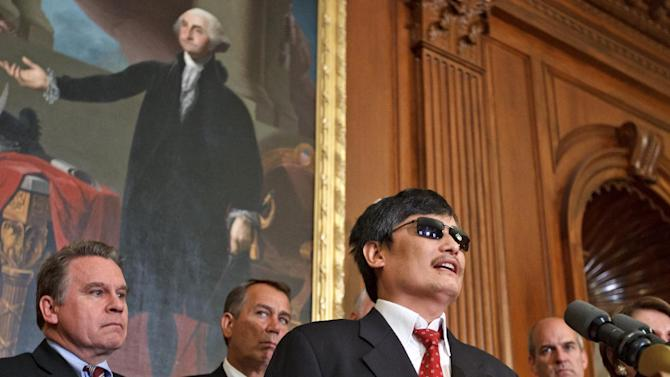 Blind Chinese dissident Chen Guangcheng speaks at an event on Capitol Hill in Washington, Wednesday, Aug. 1, 2102, hosted by House Speaker John Boehner of Ohio, and House Minority Leader Nancy Pelosi of Calif.  From left are, Rep. Christopher Smith, R-N.J., Boehner, Chen Guangcheng, and Rep. Rick Larsen, D-Wash.  (AP Photo/J. Scott Applewhite)