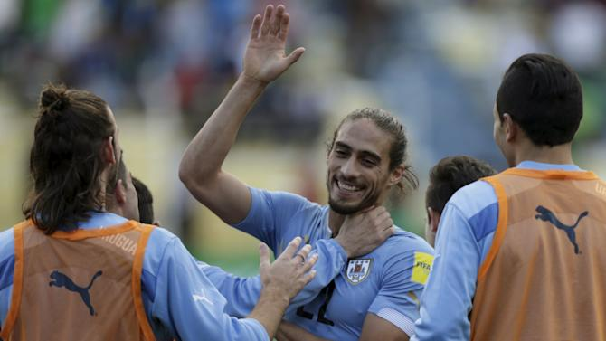 Caceres of Uruguay celebrates with teammates after their victory against Bolivia in their 2018 World Cup qualifying soccer match in La Paz, Bolivia