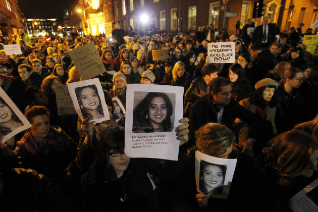 Protestors outside Leinster House in Dublin  Wednesday Nov.  14, 2012 against the death in October of Savita Halappanavar, pictured, a dentist aged 31, who was 17 weeks pregnant, after suffering a mis