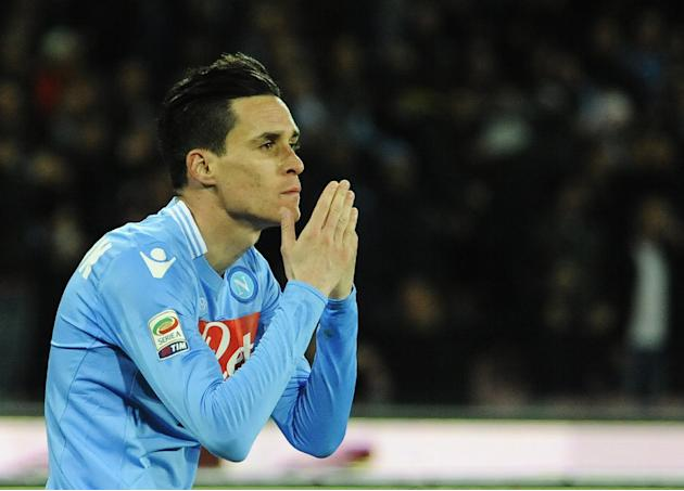 Napoli's Jos Callejn celebrates after scoring the winning goal during a Serie A soccer match between Napoli and Roma, at the San Paolo stadium in Naples, Italy, Sunday, March 9, 2014. Napoli edged