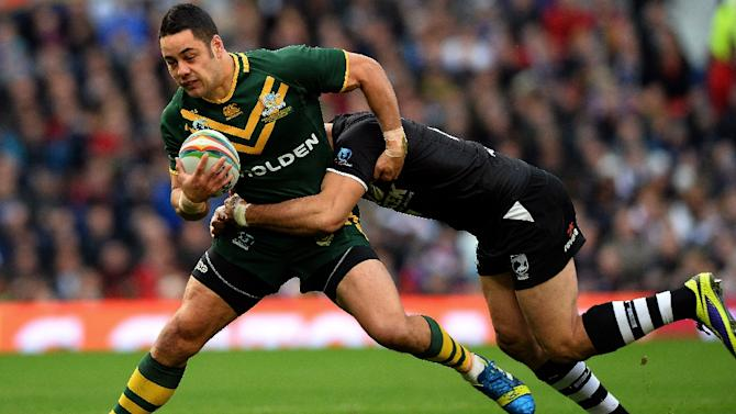 Australia's Jarryd Hayne (L) is tackled during the 2013 Rugby League World Cup Final between Australia and New Zealand at Old Trafford in Manchester on November 30, 2013