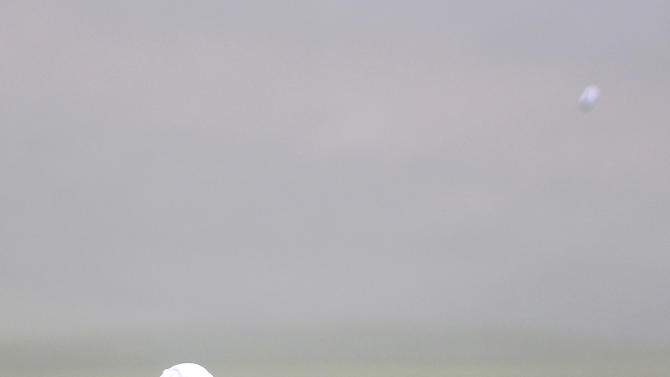 Inbee Park, from South Korea, hits a shot through the dense fog on the fairway of the 18th hole during the second round at the U.S. Women's Open golf tournament at Sebonack Golf Club in Southampton, N.Y., Friday, June 28, 2013. Play was eventually suspended because of the fog. (AP Photo/Seth Wenig)