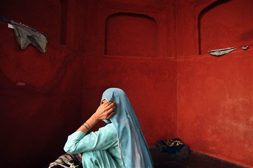 An Indian Muslim women sits inside the the Jama (Grand) mosque on the first Friday of Ramadan in New Delhi, India, Friday, July 27, 2012. Muslims throughout the world are marking the month of Ramadan,