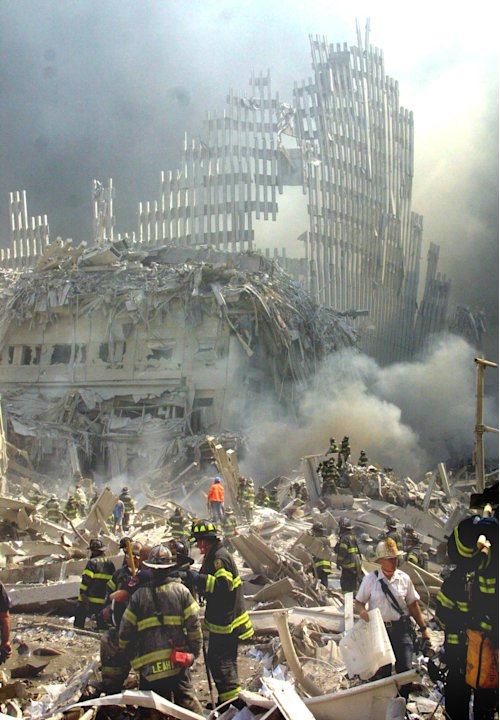 FILE - In this Sept. 11, 2001 file photo, a shell of what was once part of the facade of one of the twin towers of New York's World Trade Center rises above the rubble that remains after both towers w