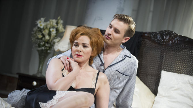 """In this undated photo released by The Od Vic theatre, actress Kim Cattrall, and actor Seth Numrich, during a scene from the production of ' Sweet Bird Of Youth' by Tennessee Williams. There's little doubt Cattrall could have coasted comfortably after creating one of the most indelible TV characters in years as the vampish Samantha Jones in """"Sex and the City."""" Since the show ended in 2004, the 56-year-old has done two """"Sex and the City"""" movies, but has also taken stage roles in London and New York in the likes of """"Private Lives"""" and """"Antony and Cleopatra."""" Still, it took some persuading by Old Vic artistic director Kevin Spacey to get her to agree to play the physically humbling, emotionally demanding role of Alexandra Del Lago, a drug-addled falling star on the run from a disastrous comeback attempt who finds herself holed up in a Gulf Coast hotel room with tarnished local golden boy Chance Wayne. (AP Photo/Tristram Kenton, Old Vic) EDITORIAL USE ONLY"""