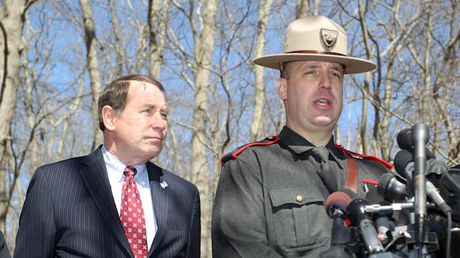 Rhode Island State Police Capt. Frank Castellone, right, and University of Rhode Island president David Dooley, left, address the media after the school ordered a lockdown of the campus in South Kingstown, R.I., Thursday, April 4, 2013. The school ended the lockdown after about 2½ hours, and said despite reports of an active shooter on the campus, an investigation revealed there was no gun or active shooter at any time. (AP Photo/Stew Milne)