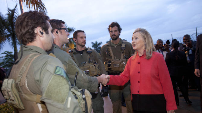 Secretary of State Hillary Rodham Clinton meets with members of diplomatic security at the U.S. Embassy in Abuja, Nigeria, Thursday, Aug. 9, 2012. (AP Photo/Jacquelyn Martin, Pool)