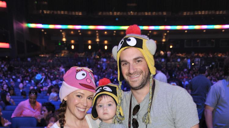 From left, Alyssa Milano, son Milo Bugliari, and David Bugliari attend Yo Gabba Gabba! Live!: Get The Sillies Out! 50+ city tour kick-off performance on Thanksgiving weekend at Nokia Theatre L.A. Live on Friday Nov. 23, 2012 in Los Angeles. (Photo by John Shearer/Invision for GabbaCaDabra, LLC./AP Images)